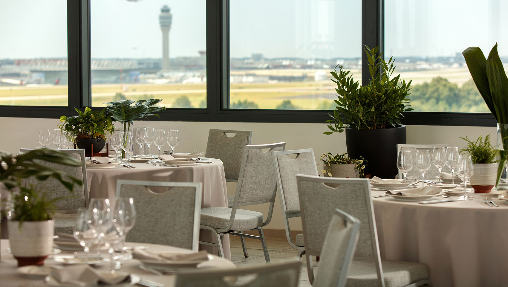 Bright Meeting Space with Airport Views